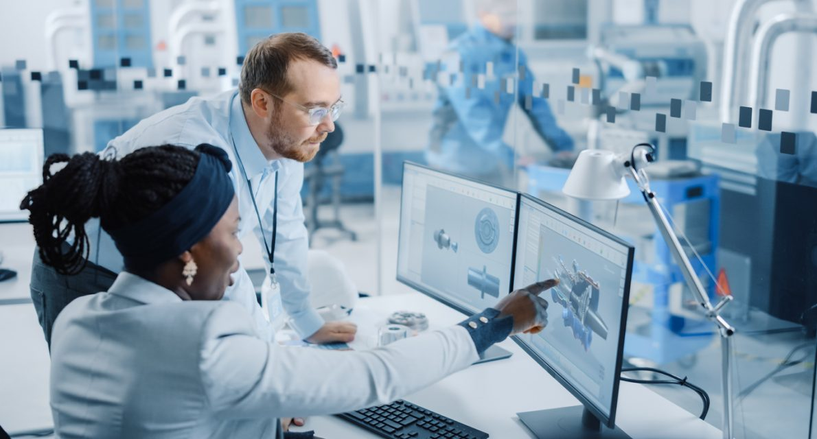 Modern Factory: Male Project Supervisor Talks to a Female Industrial Engineer who Works on Computer. They use CAD Software for Design Hybrid Electric Engine. Working High-Tech Industrial Facility